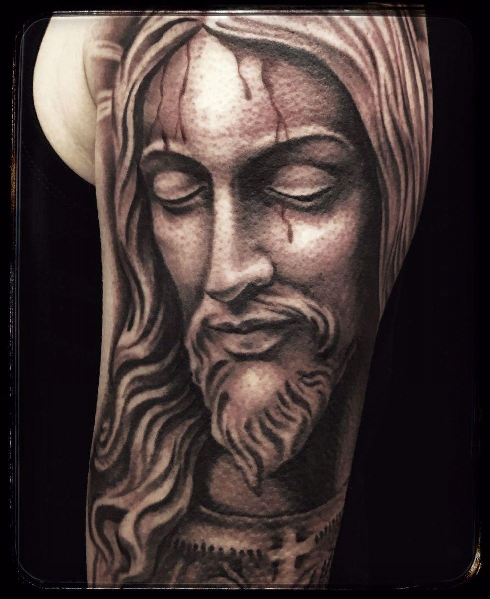 Electric punch tattoo studio walk in tattoo studio for Tattoos of black jesus